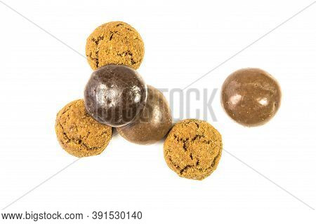 Bunch Of Traditional And Chocolate Pepernoten Treats On White Background For Annual Sinterklaas Holi