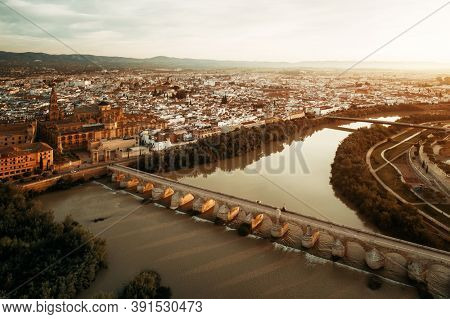 City ancient architecture of Cordoba viewed from air at sunset in Spain.