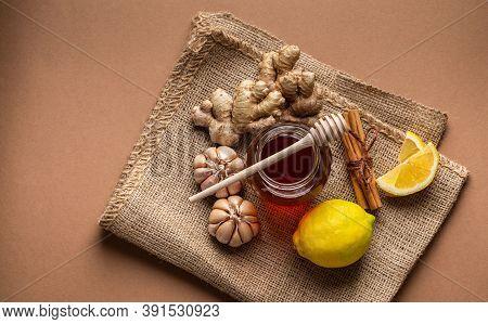 Honey Glass Pot, Ginger, Garlic, Lemon, Cinnamon Top View To Boost Immune System. Natural Food Ingre