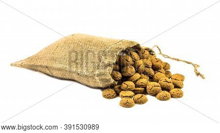 Traditional Pepernoten Treats In Jute Bag On White Background For Annual Sinterklaas Holiday Event I