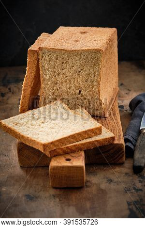 Toast Bread With Bran On A Wooden Background. Healthy Food.