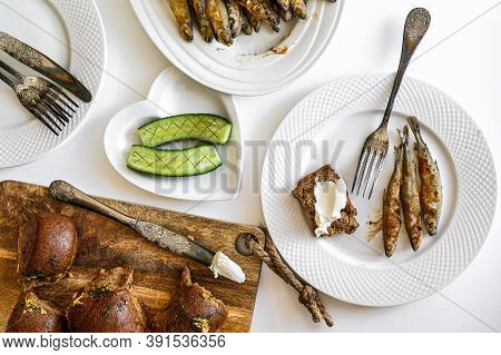 Dinner With Grilled Capelin Fish And Vegetables. White Background. Top View
