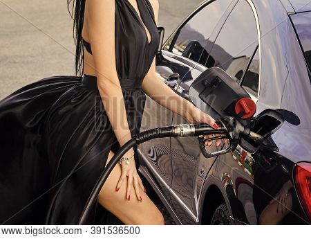 Luxury Car. Petrol Is For Rich. Sexy Female Filling Car With Gasoline. Gas Station. Woman At Gas Sta