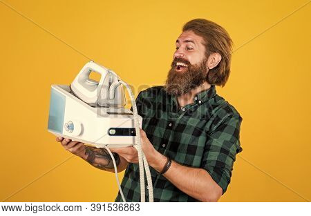 All You Need Is Iron. Man Ironing At Home. Happy Man Ironing Clothes. Man Concentrated On Ironing A