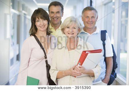 Group Of Adults Stanidng In School Corridor