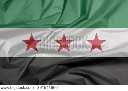 Fabric Flag Of Syrian Interim Government. Crease Of Syrian Flag Background, A Horizontal Tricolor Of
