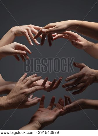 Hope. Hands Of Peoples Crows In Touch Isolated On Grey Studio Background. Concept Of Human Relation,