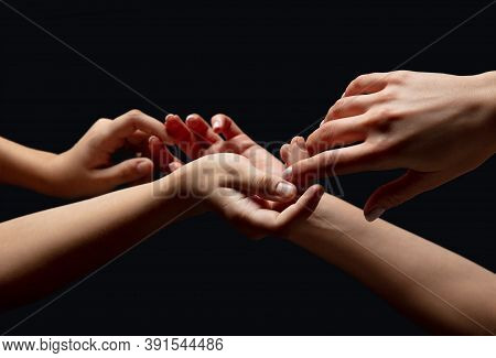 Family. Hands Of Peoples Crows In Touch Isolated On Black Studio Background. Concept Of Human Relati