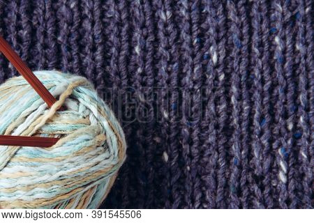Texture Beautiful Knitted Blue Fabric With Metallic Fibers And Ball Of Woolen Yarn, Knitting Needles