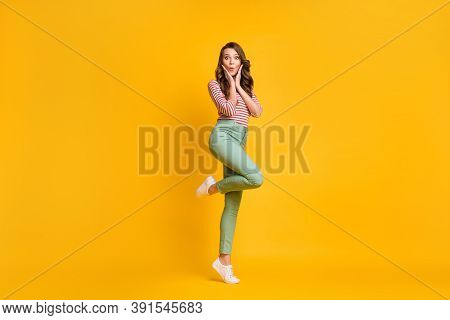 Full Length Body Size Photo Of Girl Standing Tiptoe Amazed Touching Cheekbones Isolated On Bright Ye