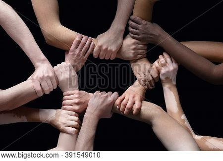 Together. Hands Of Different People In Touch Isolated On Black Studio Background. Concept Of Relatio