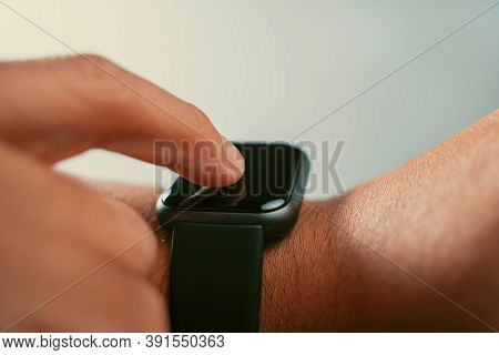 Man Using Trendy Smart Watches Mobile App On Touch Screen.new Gadget To View Incoming Messages And C