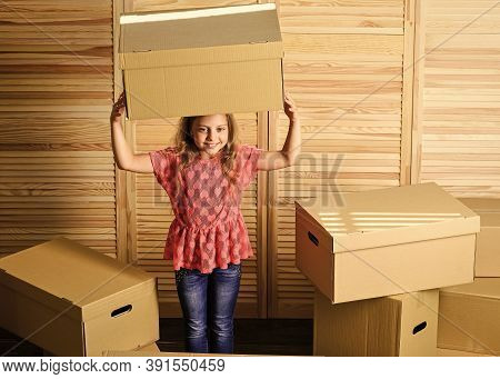 Relocating Concept. Delivery Service. Box Package And Storage. Small Child Prepare For Relocation. R