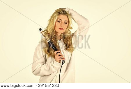Woman With Long Curly Hair Use Curling Iron. Hairdresser Equipment. Heat Setting For Hair Type. Girl