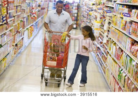Man Pushing Trolley In Supermarket