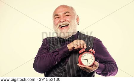 Time And Age Concept. Bearded Man Clock Ticking. Aged Man Holding Alarm Clock. Lifetime Ageing And G
