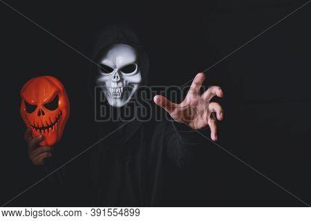 Horror Devil Costume With Spooky Pumpkin Skull In Black Dressed For Halloween Carnival. Devil Cospla