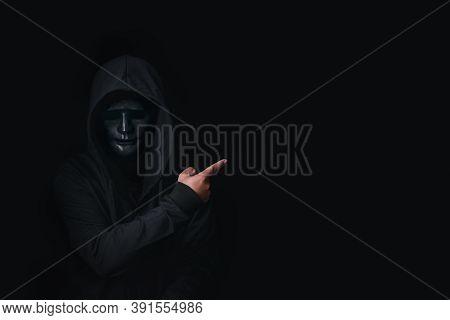 Dangerous Anonymous Hacker Man In Hooded And Mask Break Security Data And Hack Password With Bank Ac