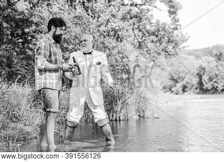 Summer Family Weekend. Father And Son Fishing. Two Fishermen With Fishing Rods. Hobby And Sport Acti