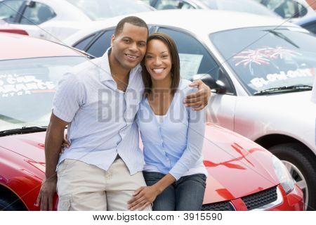 Couple Sat On Car