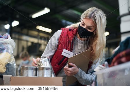 Woman Volunteer In Community Charity Donation Center, Food Bank And Coronavirus Concept.