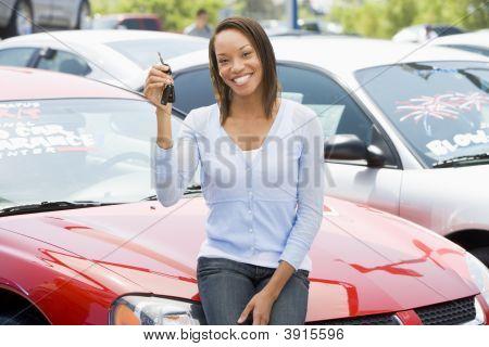 Woman Sat On Car With Keys