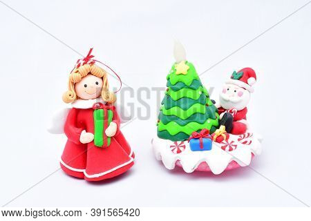 Toy Green Christmas Tree, Santa Claus With Gifts, Snow Maiden, On A White Background
