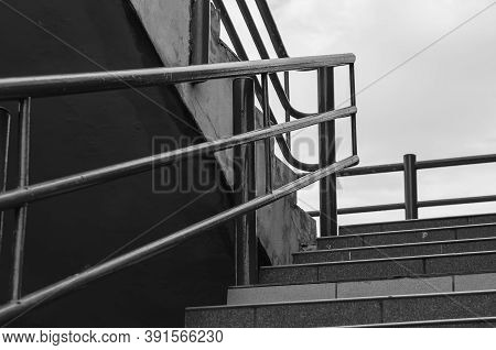 Stairs With Railing Outside. Black And White Photo Of A Stone Staircase With Metal Railing. Without