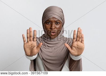 No Means No. Annoyed Black Muslim Lady In Hijab Making Refuse Stop Gesture With Two Opened Palms, Re