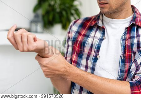 Arm Is Hurting, Wrist, Man Holds A Sore Hand