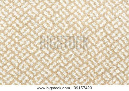 a woolen beige and white carpet with a relief pattern poster