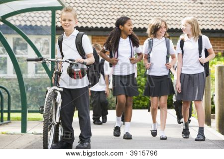 Students leaving school one with a bicycle poster
