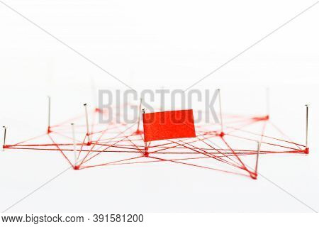 A Large Mesh Of Pins Tied Together With A Red Cord. Communication, Network Concept.