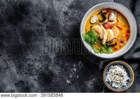 Tom Yam Kong Or Tom Yum, Clear Soup.tom Yam. Black Background. Top View. Copy Space
