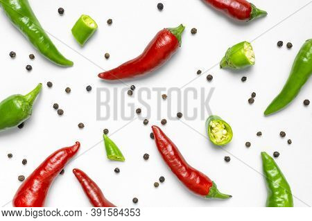 Hot Red And Green Fresh Chili Peppers, Dry Black Peppercorns On White Background Flat Lay Top View.