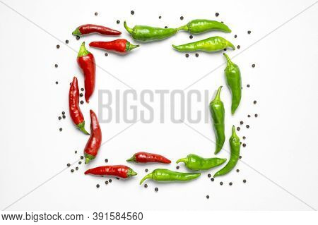 Square Frame Made Of Hot Red And Green Fresh Chili Peppers, Dry Black Peppercorns On White Backgroun