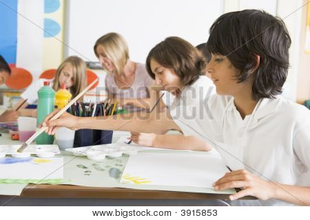 Pupils Doing Art In Classroom