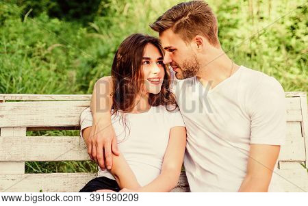 Lovers Cuddling. Couple In Love Sit On Bench. Summer Vacation. Family Weekend. Romantic Date In Park