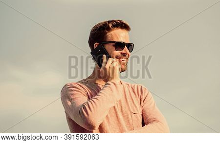 Solve Cases By Phone. Guy Casual Style. Fashion Model. Sexy Man Sky Background. Macho Man Use Mobile