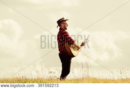 Play Beautiful Melody. Handsome Man With Guitar. Country Style. Summer Vacation. Country Music Conce