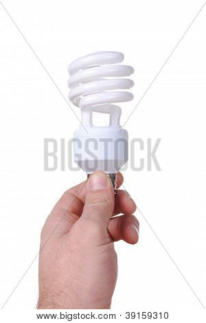 man hand holds an energy saver bulb isolated on white background