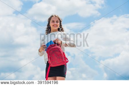 Small Kid In Sunny Day. Summer Vacation Time. Little Child Smiling In Spring Weather. Happy Curly Gi