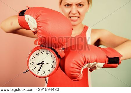 Battle For Self Discipline. Woman Holding Clock Boxing Gloves. Boxer Fighting With Alarm Clock. Time