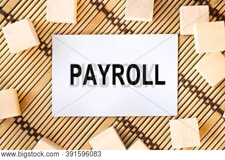 Word Concept Written On A Light Table And Light Background. Concept Word Payroll On Cubes On A Beaut