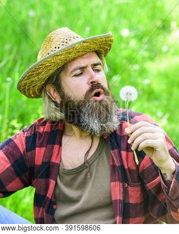 Mental Health. Peaceful Guy Blowing Dandelion. Happy And Carefree Life. Peace Of Mind. Rest And Rela