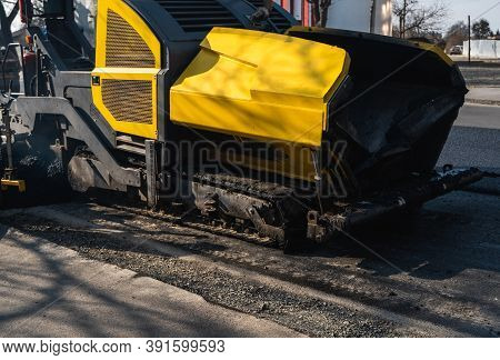 Industrial Asphalt Paver Machine Laying Fresh Asphalt On Road Construction Site On The Street. A Pav