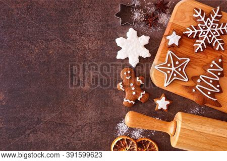 Christmas Baking Side Border With Gingerbread Cookies. Overhead View Over A Dark Stone Background Wi