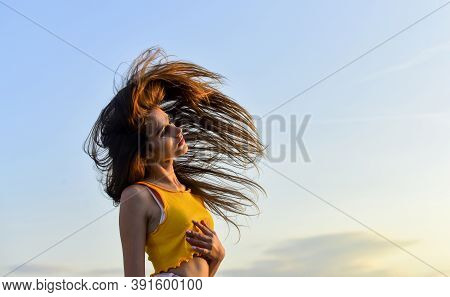 Feeling Free. Wind In Her Hair. Girl Grow Long Hair. Healthy Hair Care Habits. Strong Hair Concept.