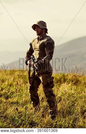 Focus And Concentration Experienced Hunter. Ready To Shoot. Army Forces. Man Military Clothes With W