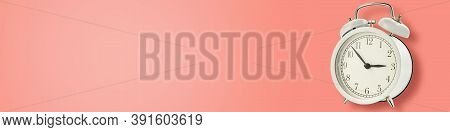 White Vintage Alarm Clock On Pink Background, Long Banner. Urgency, Deadline And Running Out Of Time